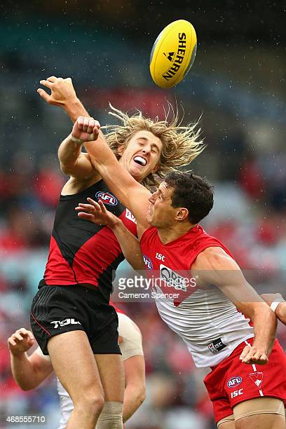 Dyson Heppell of the Bombers and Kurt Tippett of the Swans contest the ball during the Round One AFL match between the Sydney Swans and the Essendon...