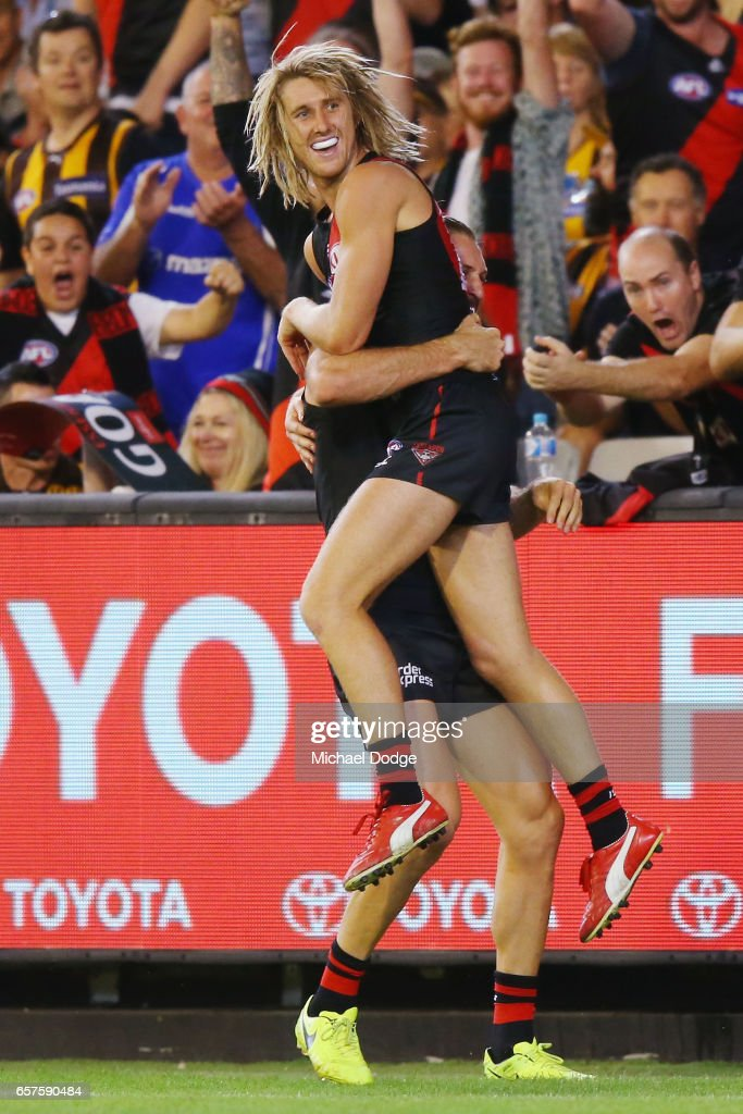 Dyson Heppell of the Bombers celebrates a goal with Cale Hooker during the round one AFL match between the Essendon Bombers and the Hawthorn Hawks at Melbourne Cricket Ground on March 25, 2017 in Melbourne, Australia.