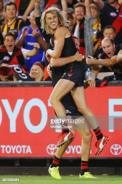 Dyson Heppell of the Bombers celebrates a goal with Cale Hooker during the round one AFL match between the Essendon Bombers and the Hawthorn Hawks at...