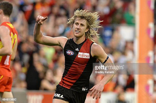 Dyson Heppell of the Bombers celebrates kicking a goal during the round 21 AFL match between the Gold Coast Suns and the Essendon Bombers at Metricon...