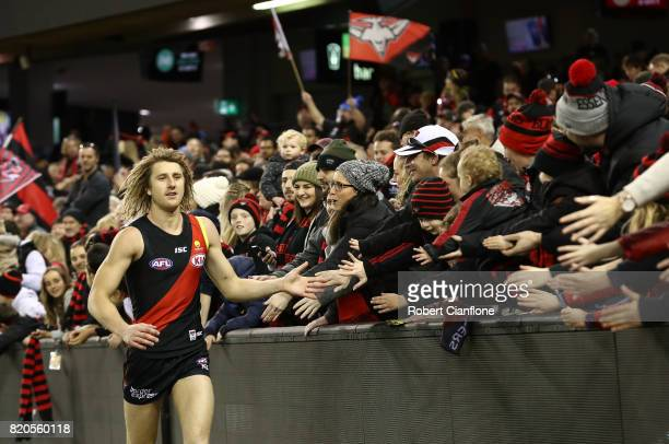 Dyson Heppell of the Bombers celebrates with the fans after the Bombers defeated the Kangaroos during the round 18 AFL match between the Essendon...