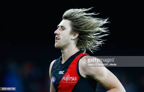 Dyson Heppell of the Bombers during the round 22 AFL match between the Gold Coast Suns and the Essendon Bombers at Metricon Stadium on August 19 2017...