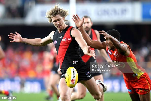Dyson Heppell of the Bombers gets a kick away during the round 22 AFL match between the Gold Coast Suns and the Essendon Bombers at Metricon Stadium...