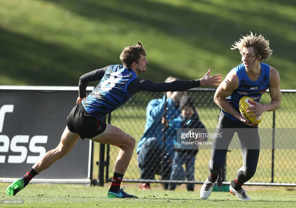 Dyson Heppell of the Bombers is chased by Martin Gleeson during an Essendon Bombers AFL training session at the Essendon Football Club on August 16, 2017 in Melbourne, Australia.