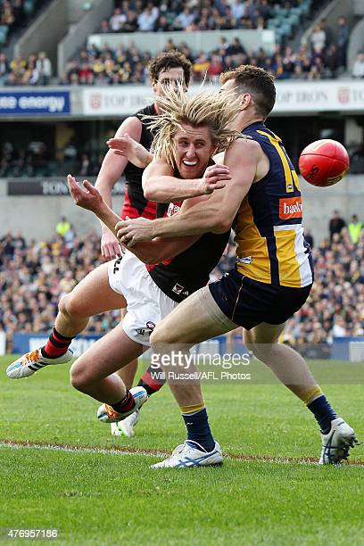 Dyson Heppell of the Bombers is tackled by Luke Shuey of the Eagles during the round 11 AFL match between the West Coast Eagles and the Essendon...