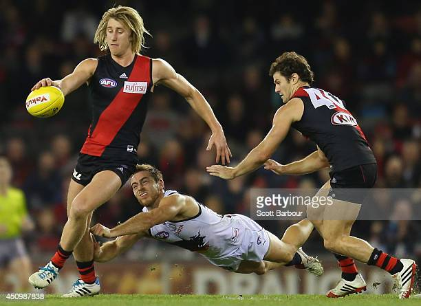 Dyson Heppell of the Bombers kicks the ball during the round 14 AFL match between the Essendon Bombers and the Adelaide Crows at Etihad Stadium on...