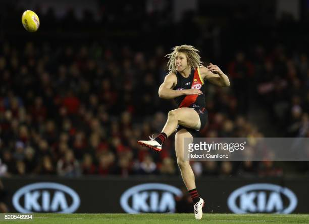 Dyson Heppell of the Bombers kicks the ball during the round 18 AFL match between the Essendon Bombers and the North Melbourne Kangaroos at Etihad...