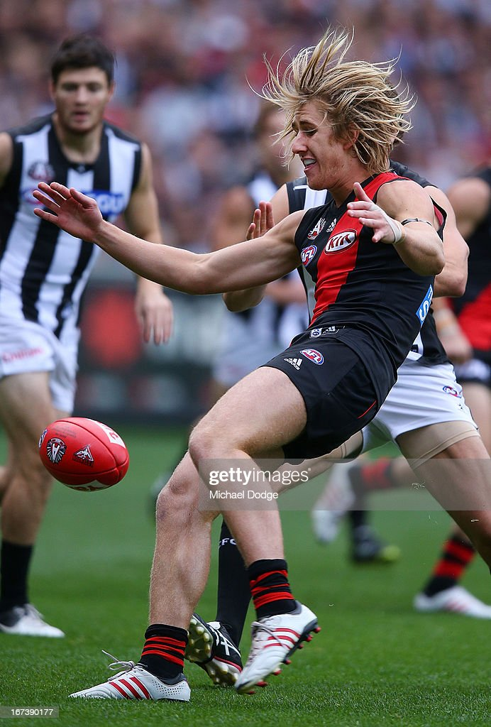 Dyson Heppell of the Bombers kicks the ball during the round five AFL match between the Essendon Bombers and the Collingwood Magpies at Melbourne Cricket Ground on April 25, 2013 in Melbourne, Australia.