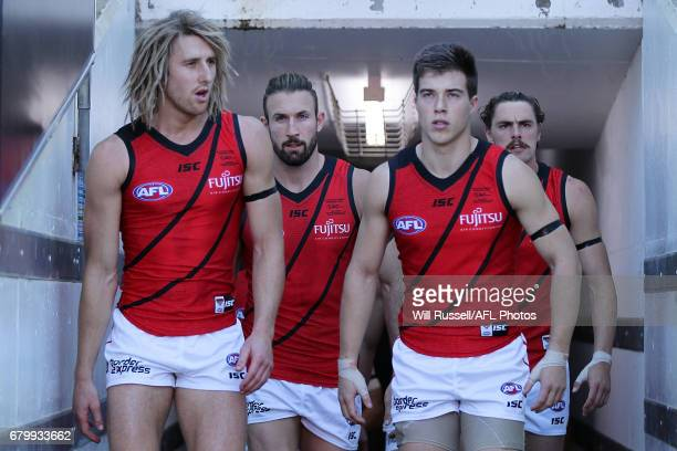 Dyson Heppell of the Bombers leads the team out during the round seven AFL match between the Fremantle Dockers and the Essendon Bombers at Domain...