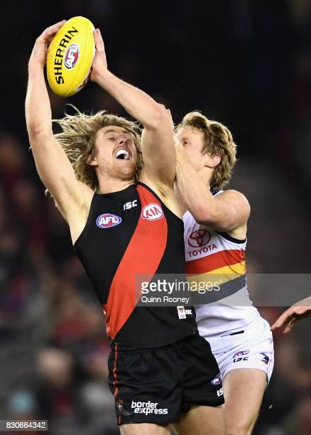 Dyson Heppell of the Bombers marks infront of Rory Sloane of the Crows during the round 21 AFL match between the Essendon Bombers and the Adelaide...