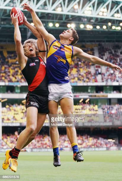 Dyson Heppell of the Bombers marks the ball against Jack Redden of the Eagles during the round nine AFL match between the Essendon Bombers and the...