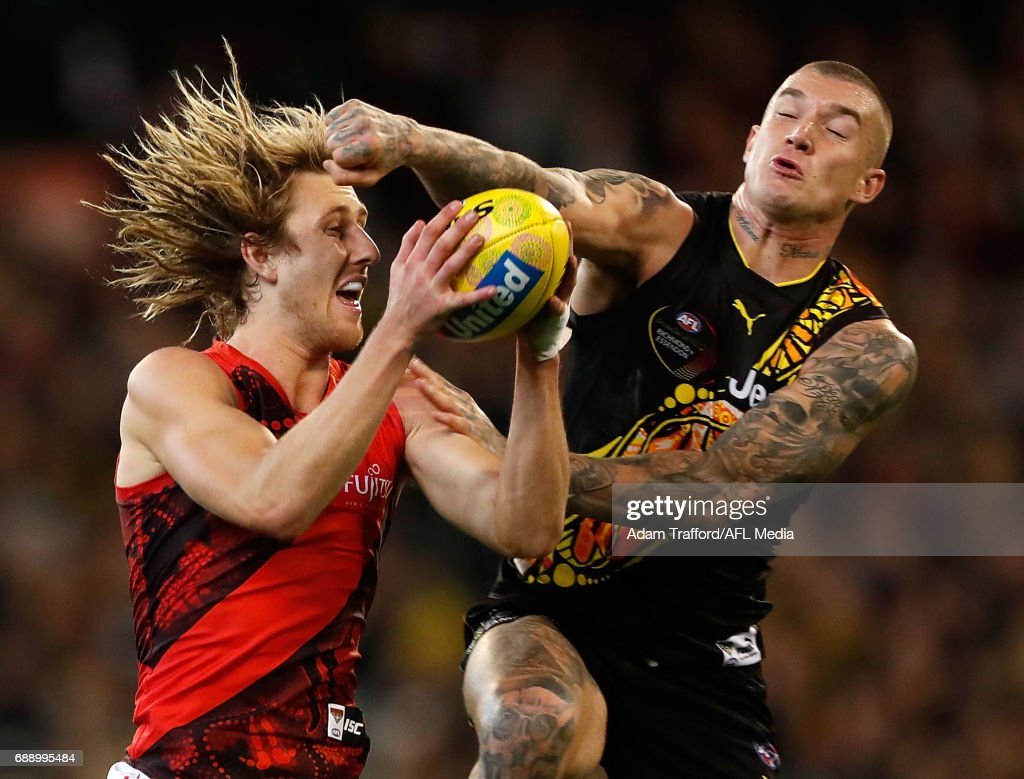 Dyson Heppell of the Bombers marks the ball ahead of Dustin Martin of the Tigers during the 2017 AFL round 10 Dreamtime at the G match between the Richmond Tigers and the Essendon Bombers at the Melbourne Cricket Ground on May 27, 2017 in Melbourne, Australia.