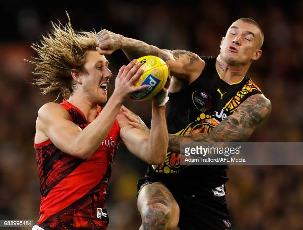 Dyson Heppell of the Bombers marks the ball ahead of Dustin Martin of the Tigers during the 2017 AFL round 10 Dreamtime at the G match between the...