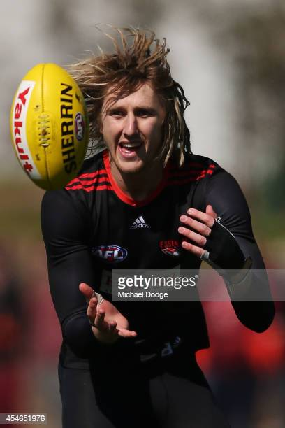Dyson Heppell of the Bombers marks the ball with his injured left hand during an Essendon Bombers AFL training session at True Value Solar Centre on...