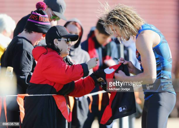 Dyson Heppell of the Bombers signs autographs for fans during an Essendon Bombers AFL training session at True Value Centre on June 20 2017 in...