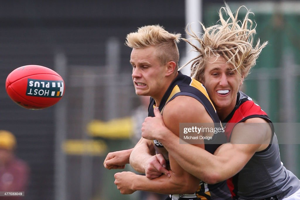 Dyson Heppell of the Bombers tackles Brandon Ellis of the Tigers during an AFL Practice Match between the Richmond Tigers and the Essendon Bombers at Punt Road Oval on March 7, 2014 in Melbourne, Australia.