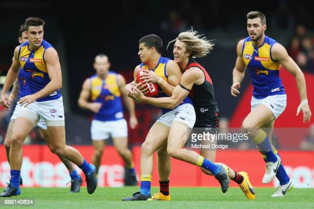 Dyson Heppell of the Bombers tackles Liam Duggan of the Eagles during the round nine AFL match between the Essendon Bombers and the West Coast Eagles...