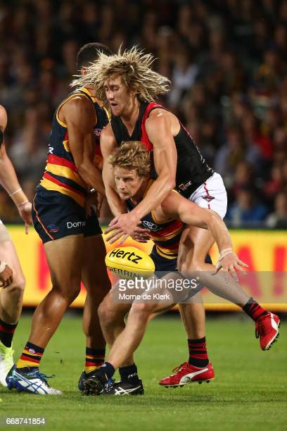 Dyson Heppell of the Bombers tackles Rory Sloane of the Crows during the round four AFL match between the Adelaide Crows and the Essendon Bombers at...