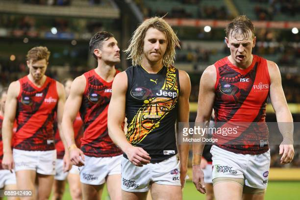 Dyson Heppell of the Bombers walks off wearing a Tigers jumper next to Brendon Goddard of the Bombers after defeat during the round 10 AFL match...