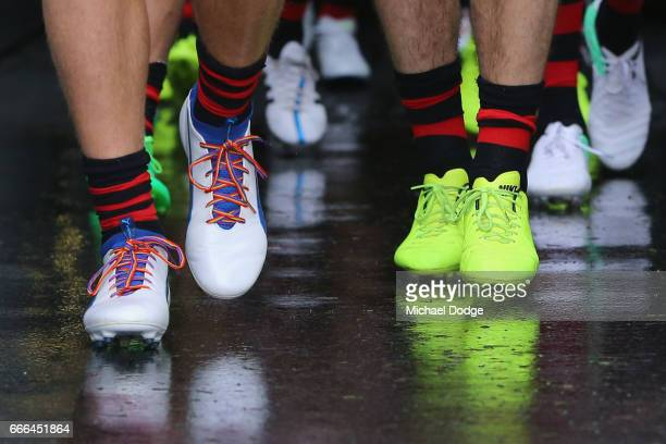 Dyson Heppell of the Bombers wears rainbow coloured laces as he leads the team out during the round three AFL match between the Carlton Blues and the...