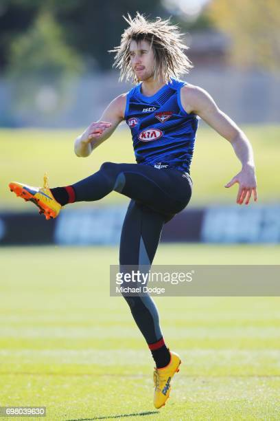 Dyson Heppell of the Bomberskicks the ball during an Essendon Bombers AFL training session at True Value Centre on June 20 2017 in Melbourne Australia
