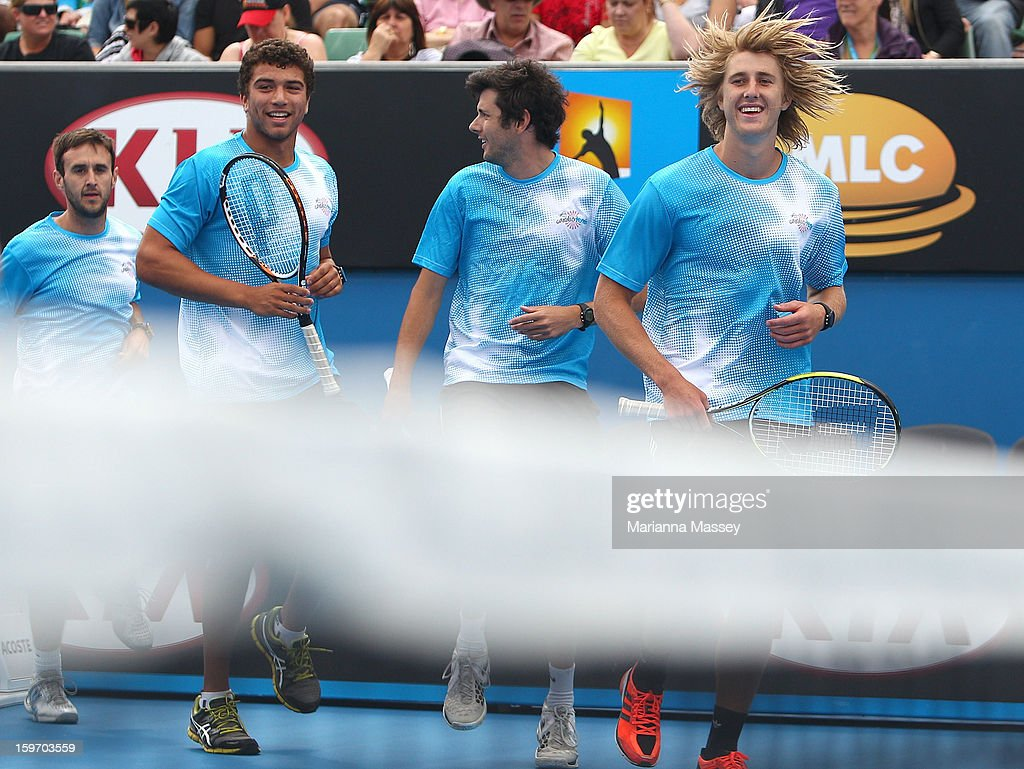 Dyson Heppell of the Essendon Football Club and Ben Ali Darrou from Richmond participate in the cardio tennis session on Margaret Court on day six of the 2013 Australian Open at Melbourne Park on January 19, 2013 in Melbourne, Australia.