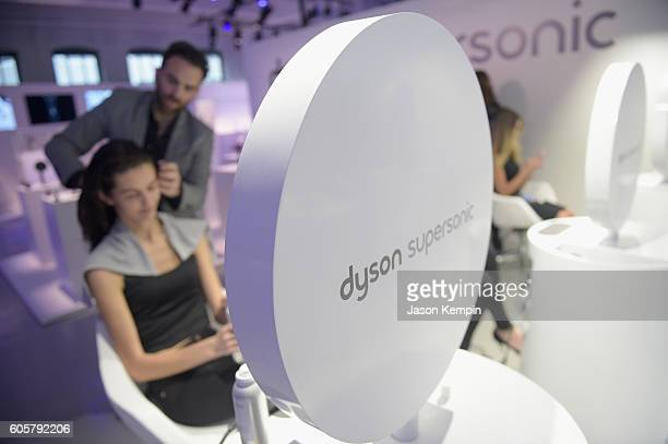 Dyson representative styles a model during the Dyson Supersonic Hair Dryer launch event at Center548 on September 14 2016 in New York City