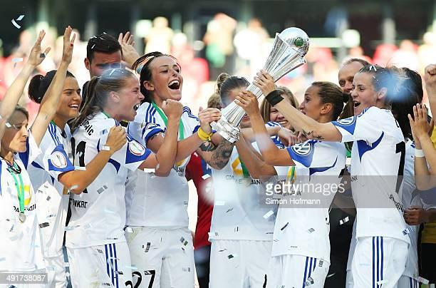 Dzenifer Maroszan AnaMaria Crnogorecevic Peggy Kuznik Fatmire Alushi and Simone Laudehr of Frankfurt celebrate winning with the trophy after the...