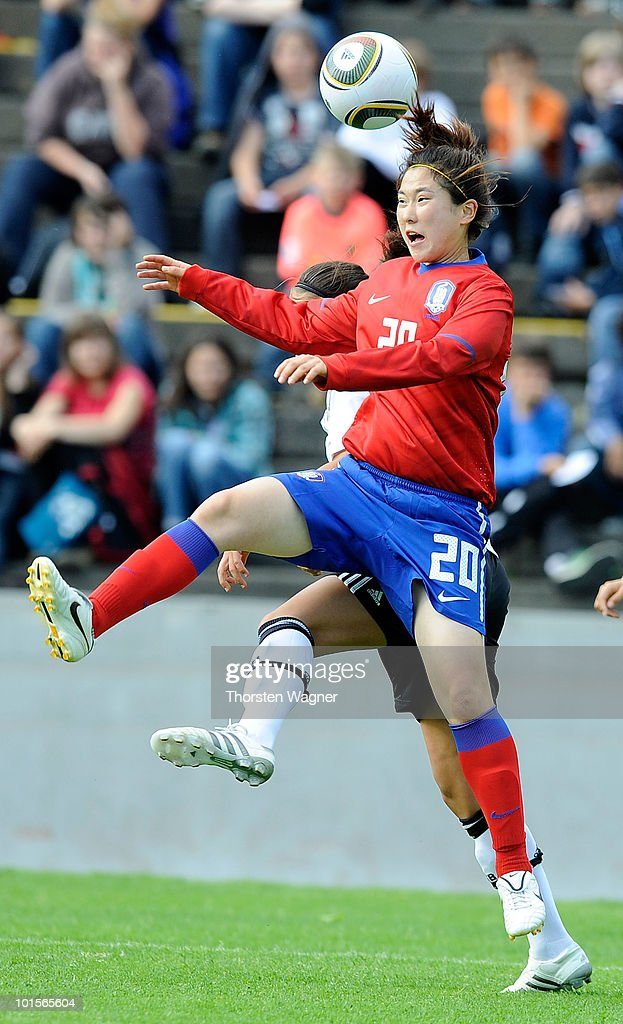 Dzenifer Marozsan (L) of Germany battles for the ball with Song Ari (R) of South Korea during the U20 international friendly match between Germany and South Korea at Waldstadion on June 2, 2010 in Giessen, Germany.