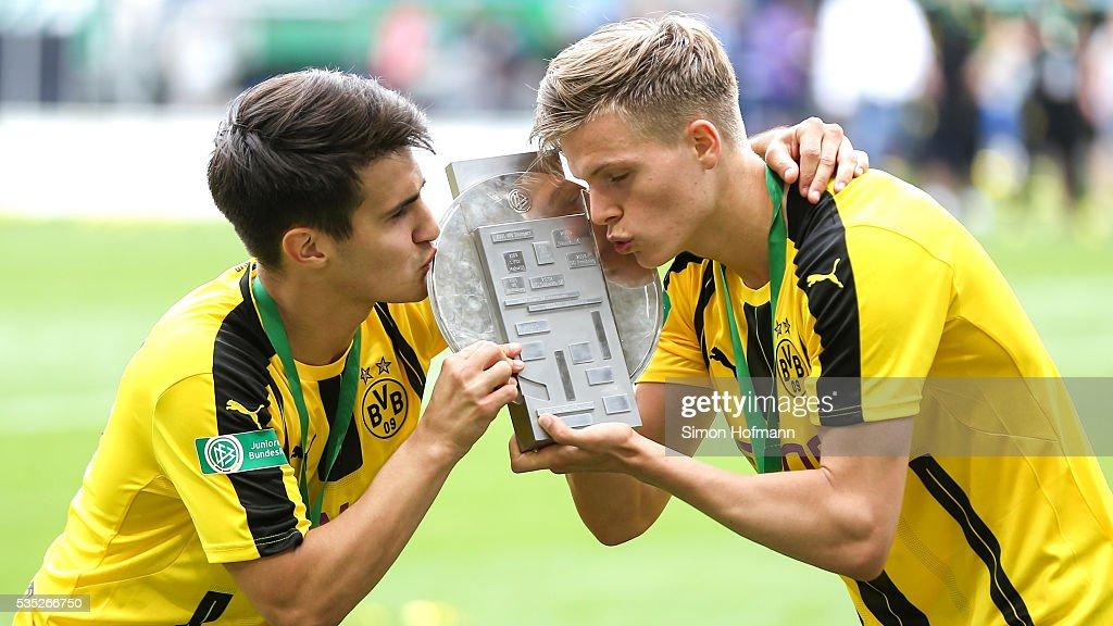Dzenis Burnic and Berkant Guener of Dortmund celebrate with the trophy after the A Juniors German Championship Final match between 1899 Hoffenheim U19 and Borussia Dortmund U19 at Wirsol Rhein-Neckar-Arena on May 29, 2016 in Sinsheim, Germany.