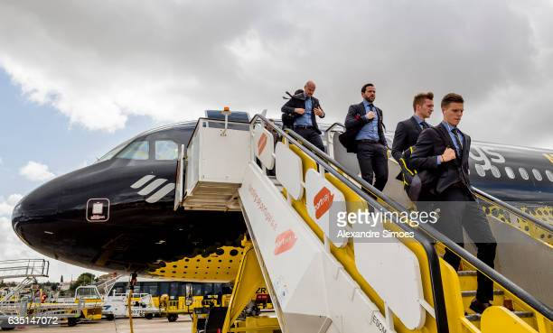 Dzenis Burnic Marco Reus and Gonzalo Castro of Borussia Dortmund after arriving at Lisbon Portela Airport prior to the UEFA Champions League Round of...