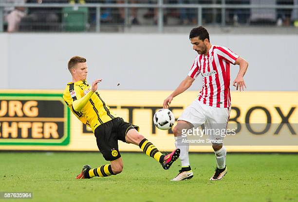Dzenis Burnic of Borussia Dortmund challenges Javier Boveda of Athletic Bilbao during the friendly match between Athletic Bilbao and Borussia...