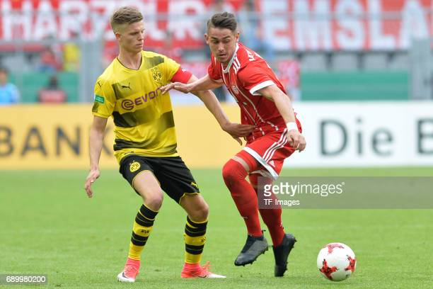 Dzenis Burnic of Dortmund and Meritan Shabani of Munich battle for the ball during the U19 German Championship Final match between U19 Borussia...