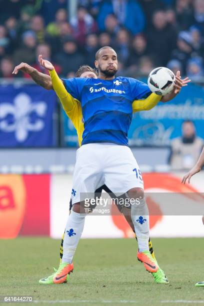 Dzenis Burnic of Dortmund and Terrence Boyd of Darmstadt battle for the ball during the Bundesliga match between SV Darmstadt 98 and Borussia...