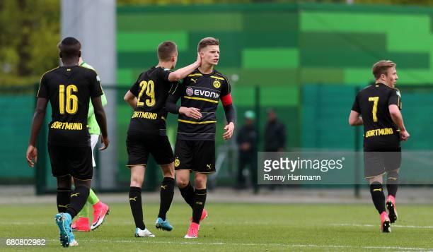 Dzenis Burnic of Dortmund celebrates after scoring his team's second goal with Orel Mangala David Kopacz and Felix Passlack of Dortmund during the...