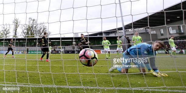 Dzenis Burnic of Dortmund celebrates after scoring his team's third goal against goalkeeper Phillip Menzel of Wolfsburg during the AJuniors German...