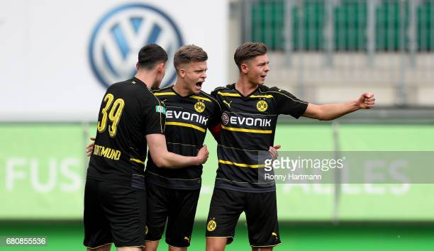 Dzenis Burnic of Dortmund celebrates after scoring his team's third goal with JanniLuca Serra and Alexander Laukart of Dortmund during the AJuniors...