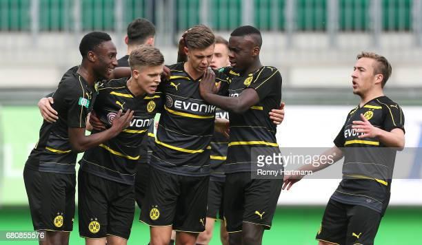 Dzenis Burnic of Dortmund celebrates after scoring his team's third goal with team mates during the AJuniors German Championship semi final first leg...