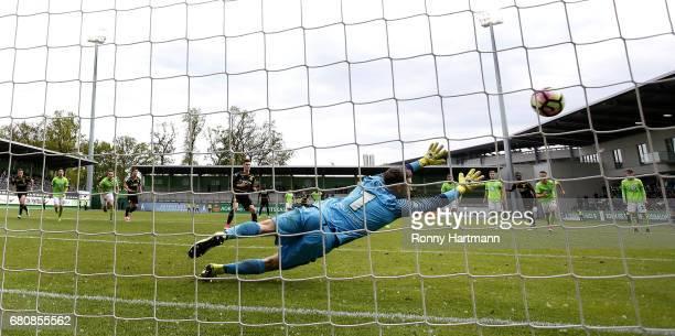 Dzenis Burnic of Dortmund scores his team's third goal against goalkeeper Phillip Menzel of Wolfsburg during the AJuniors German Championship semi...