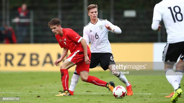 Dzenis Burnic of Germany and Fabian Rohner of Switzerland compete for the ball during the international friendly U20 match between U20 Germany and...