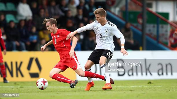 Dzenis Burnic of Germany and Michel Aebischer of Switzerland compete for the ball during the international friendly U20 match between U20 Germany and...