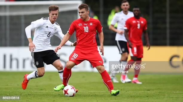 Dzenis Burnic of Germany and Vasilije Janjicic of Switzerland compete for the ball during the international friendly U20 match between U20 Germany...