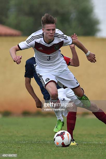 Dzenis Burnic of Germany is tackled by Timothe Cognat of France during the International Friendly match between U16 France and U16 Germany at Stade...
