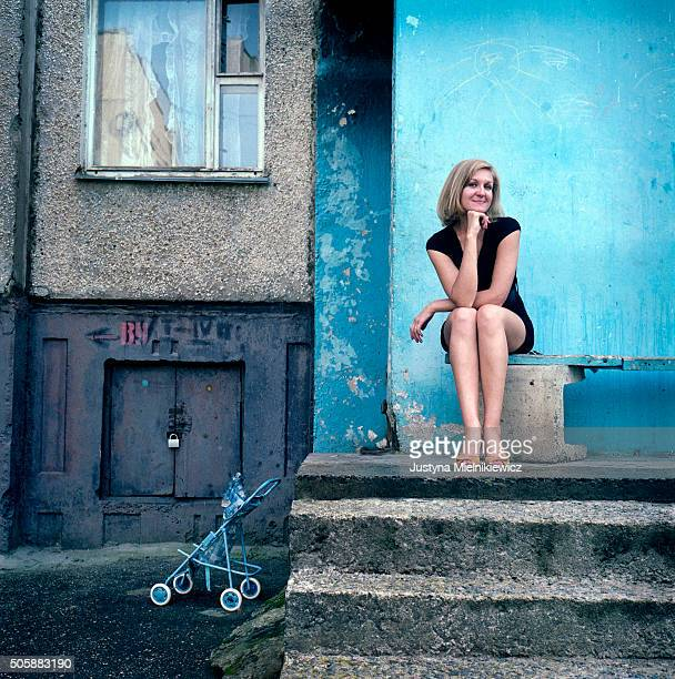 Dzina Urbanovich poses for a photo in front of the house she rents her apartment at on July 18 2011 in Grodno Belarus Dzina is single and works as a...