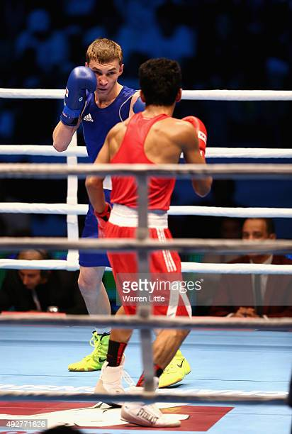 Dzmitry Asanau of Belarus fights Shiva Thapa of India after final of the Men's Bantam Weight during the AIBA World Boxing Championships Doha 2015 at...