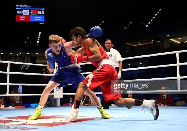 Dzmitry Asanau of Belarus fights Shiva Thapa of India in the final of the Men's Bantam Weight during the AIBA World Boxing Championships Doha 2015 at...