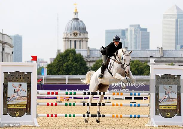 Dzmitry Meliakh of Belarus riding Randel competes in the Riding Show Jumping during the Men's Modern Pentathlon on Day 15 of the London 2012 Olympic...