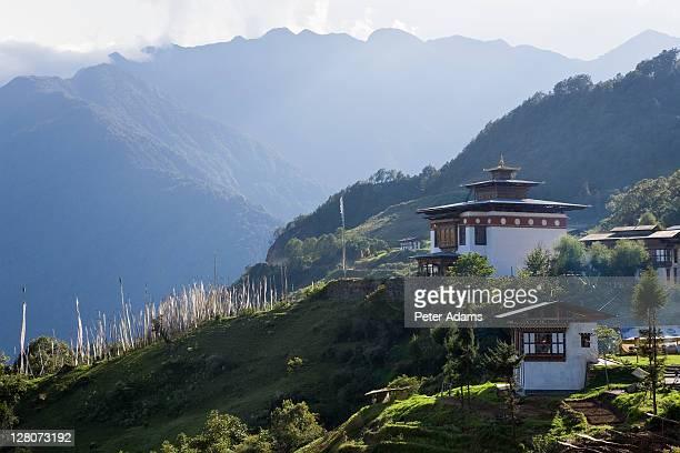 Dzong or monastery with prayer flags, Bumthang, Bhutan