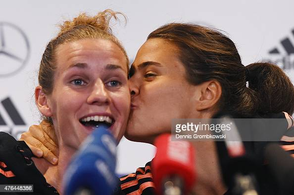 Dzsenifer Maroszan of Germany gives her team mate Simone Laudehr a peck on the cheek as she is asked about her opinion about Dzsenifer Maroszan...