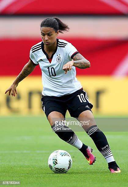 Dzsenifer Maroszan of Germany runs with the ball during the women's international friendly match between Germnay and Ghana at Benteler Arena on July...